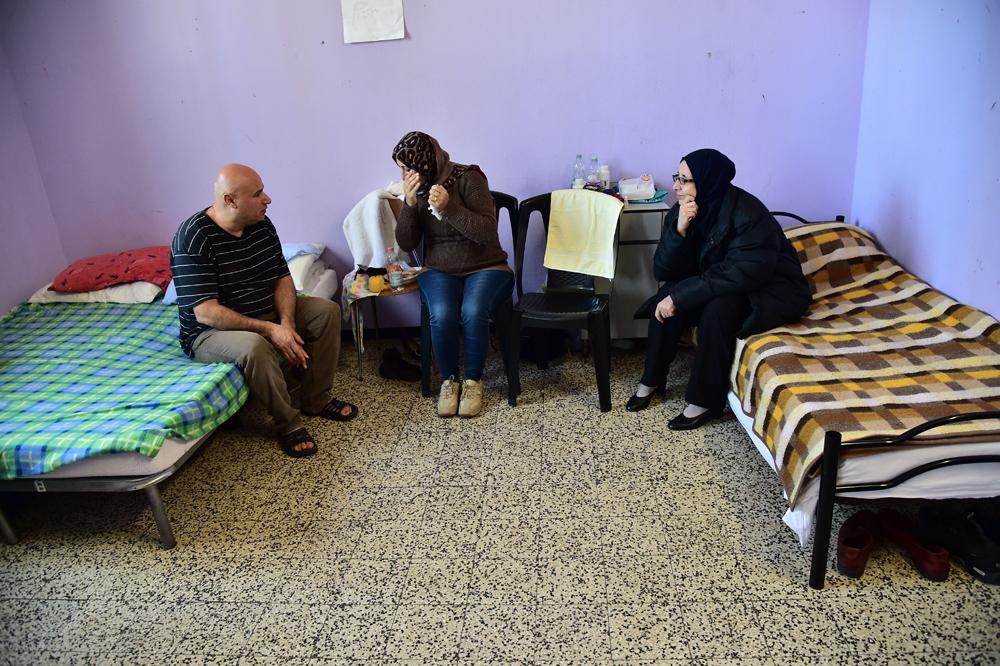 Profughi siriani in un centro di accoglienza a Milano, il 5 gennaio 2015. - Giuseppe Cacace, Afp/Getty Images
