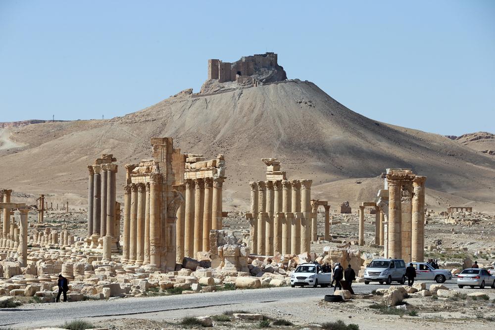I resti dell'arco di trionfo di Palmira, in Siria, il 31 marzo 2016. - Joseph Eid, Afp