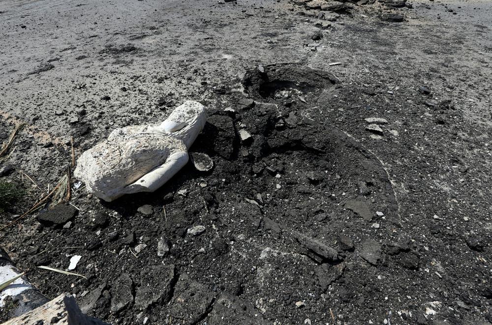 I resti di una statua nella periferia di Palmira, in Siria, il 31 marzo 2016. - Joseph Eid, Afp