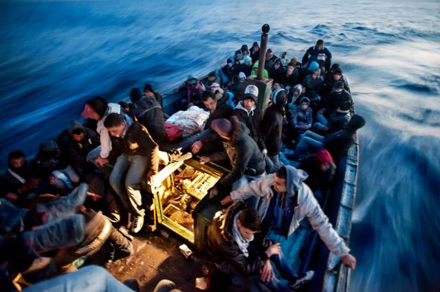 Quattro fotografi raccontano l'emergenza dei migranti